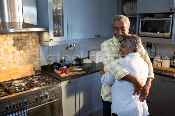 Affectionate couple with eyes closed embracing while standing in kitchen Stock photo © wavebreak_media