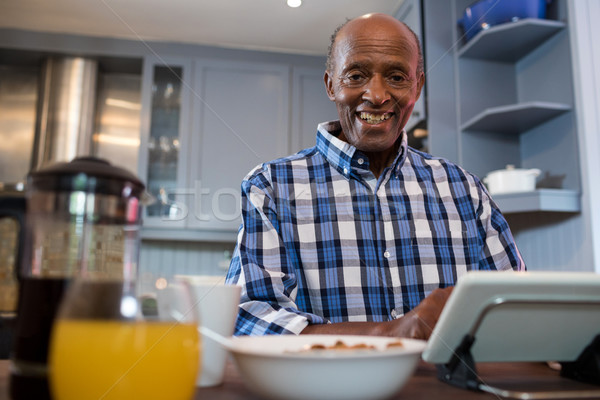 Portrait of senior man using tablet Stock photo © wavebreak_media
