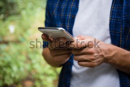 Mid-section of man using mobile phone Stock photo © wavebreak_media