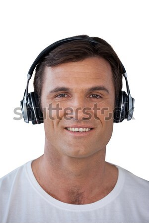 Happy mature man wearing headphones looking away Stock photo © wavebreak_media