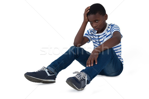 Sad boy sitting with hand on head Stock photo © wavebreak_media