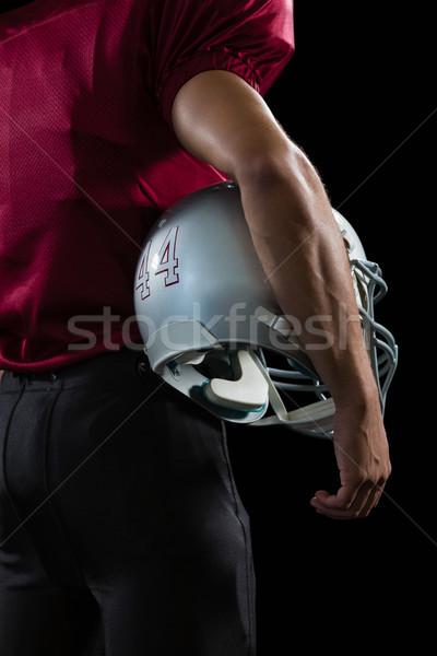 Amerikai futballista tart fej viselet karok Stock fotó © wavebreak_media
