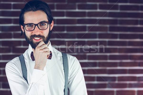 Portrait of smiling man with hand on chin Stock photo © wavebreak_media