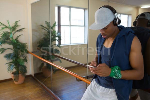 Male dancer using phone in studio Stock photo © wavebreak_media