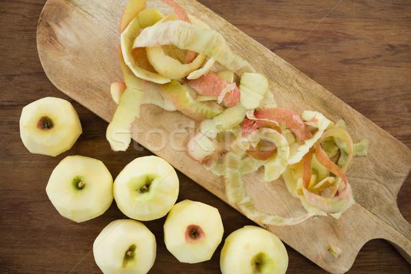 Overhead view of fresh apples by peels on cutting board Stock photo © wavebreak_media