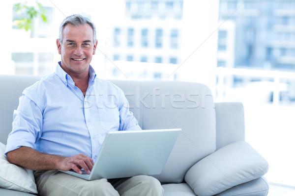 счастливым человека рабочих ноутбука домой портрет Сток-фото © wavebreak_media