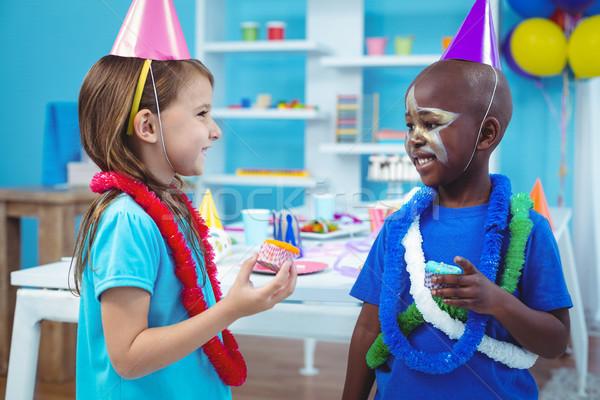 Feliz ninos sabroso fiesta de cumpleaños nina Foto stock © wavebreak_media