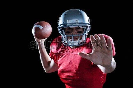 American football player in jersey and helmet holding ball Stock photo © wavebreak_media