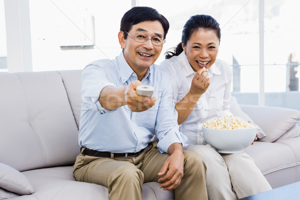 Smiling man and woman sitting on couch Stock photo © wavebreak_media