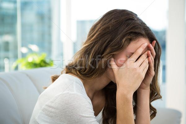悲しい 女性 ソファ 頭 ホーム ストックフォト © wavebreak_media