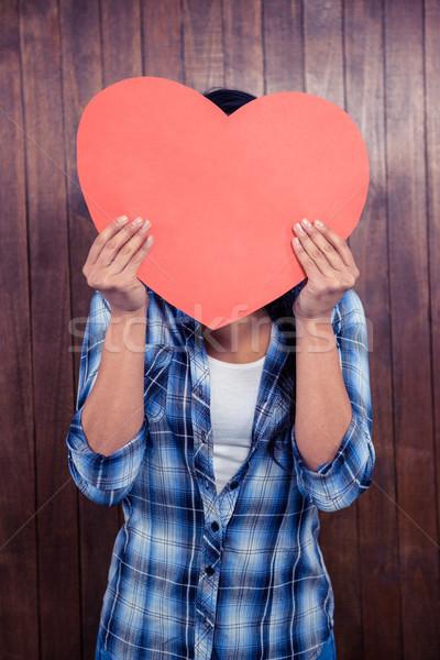 Kadın gizleme yüz arkasında kâğıt kalp Stok fotoğraf © wavebreak_media