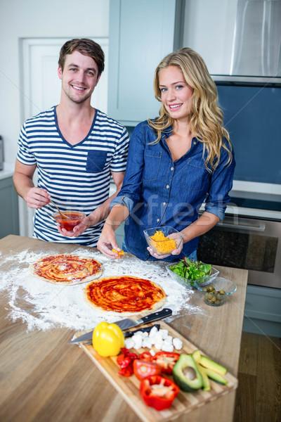 Smiling couple preparing pizza Stock photo © wavebreak_media