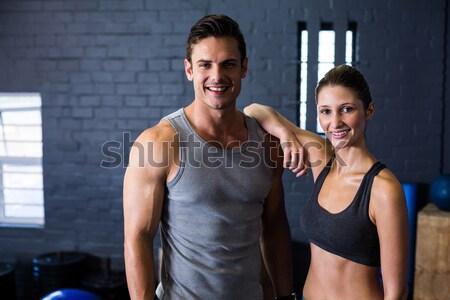 Smiling fit couple embracing Stock photo © wavebreak_media
