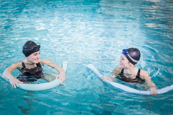Smiling women in the pool with foam rollers Stock photo © wavebreak_media