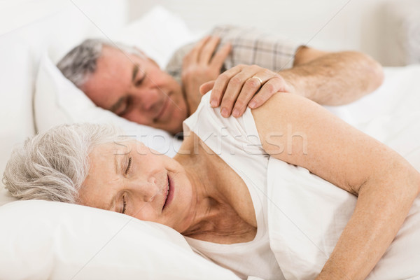 Senior couple sleeping in bed Stock photo © wavebreak_media