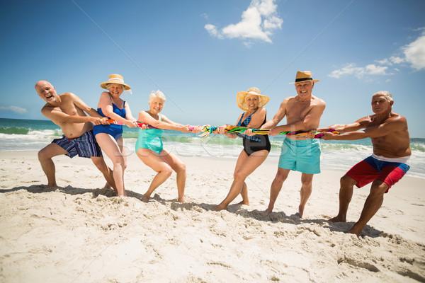 Seniors playing tug of war at the beach Stock photo © wavebreak_media