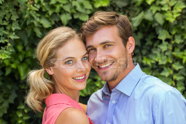 Happy romantic couple at front yard Stock photo © wavebreak_media