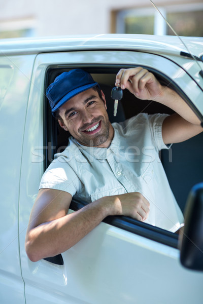 Portrait of smiling delivery man showing car keys  Stock photo © wavebreak_media
