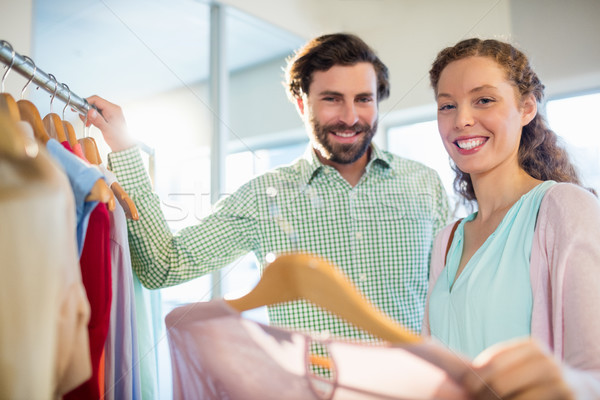 Woman showing shirt to man at shopping mall Stock photo © wavebreak_media