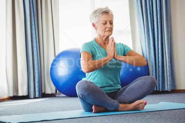 Portré idős nő ül lótusz pozició Stock fotó © wavebreak_media