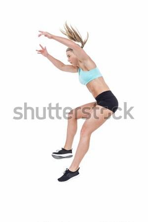 Female athlete jumping Stock photo © wavebreak_media