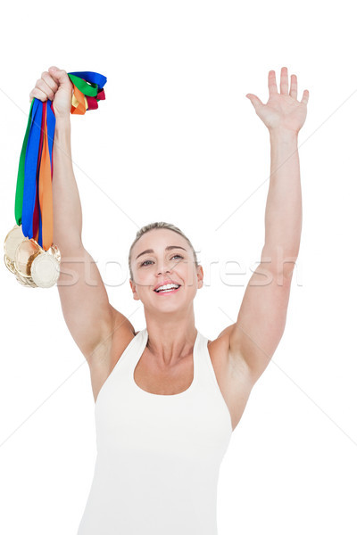 Happy female athlete holding medals Stock photo © wavebreak_media