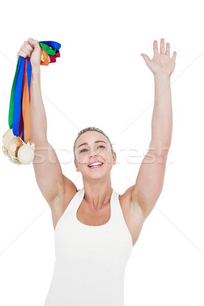 Glücklich weiblichen Athleten halten Medaillen weiß Stock foto © wavebreak_media