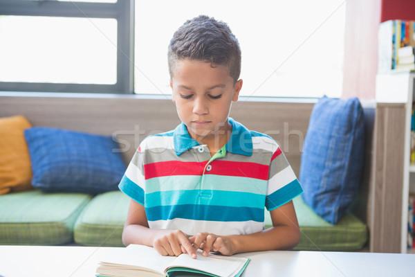 écolier lecture livre bibliothèque école enfant Photo stock © wavebreak_media