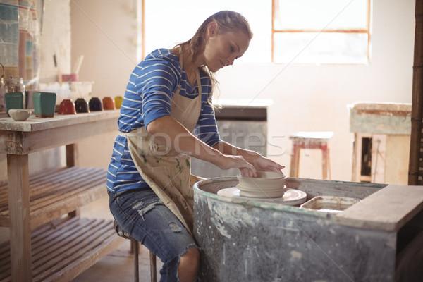 Beautiful female potter making pot Stock photo © wavebreak_media