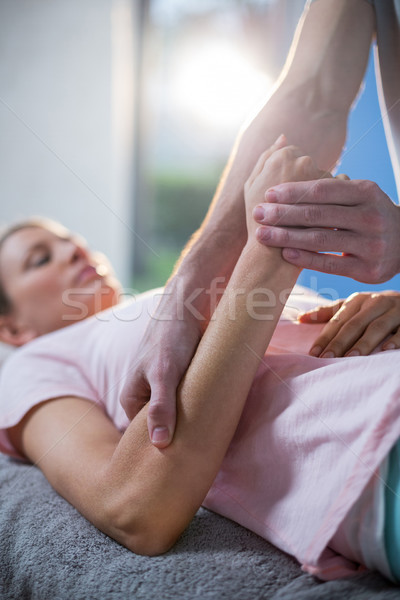 Physiotherapist massaging hand of a female patient Stock photo © wavebreak_media