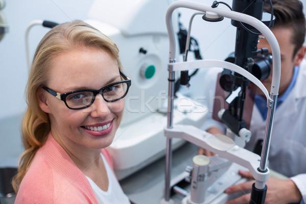 Optometrist examining female patient on slit lamp Stock photo © wavebreak_media