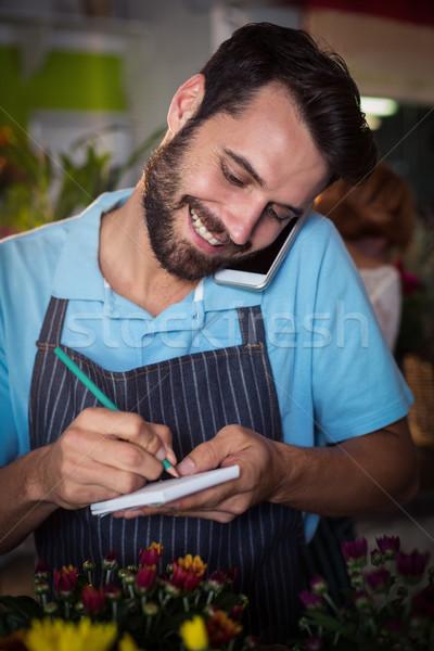 男性 花屋 注文 携帯電話 花屋 ストックフォト © wavebreak_media