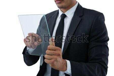 Om de afaceri futuristic telefon mobil alb afaceri sticlă Imagine de stoc © wavebreak_media