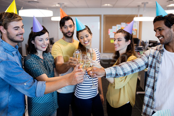 Criador equipe de negócios brinde aniversário escritório negócio Foto stock © wavebreak_media
