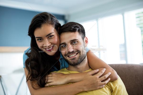 Portré mosolyog pár átkarol egyéb nappali Stock fotó © wavebreak_media