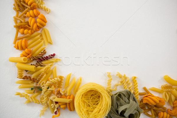 Varieties of pasta arranged on white background Stock photo © wavebreak_media