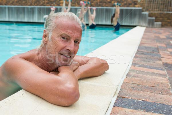 Senior man leaning on poolside Stock photo © wavebreak_media