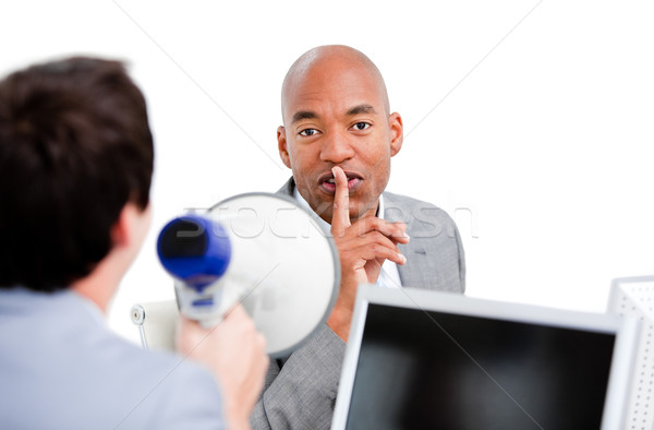 Afro-american businessman asking for silece while his colleague  Stock photo © wavebreak_media
