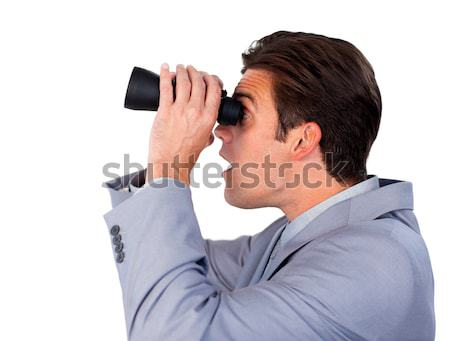 Visionary businesswoman looking through binoculars Stock photo © wavebreak_media