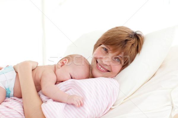 Happy mother embracing her newborn baby Stock photo © wavebreak_media