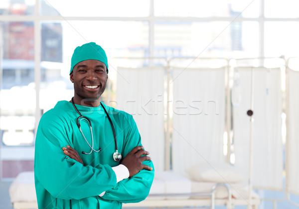 Sorridere chirurgo guardando fotocamera ospedale sorriso Foto d'archivio © wavebreak_media