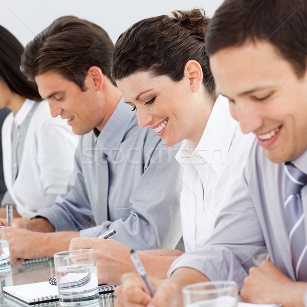 Fiatal üzletemberek jegyzetel konferencia iroda megbeszélés Stock fotó © wavebreak_media
