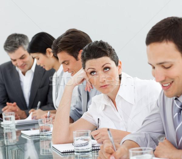 Brunette femme d'affaires s'ennuie réunion femme Photo stock © wavebreak_media