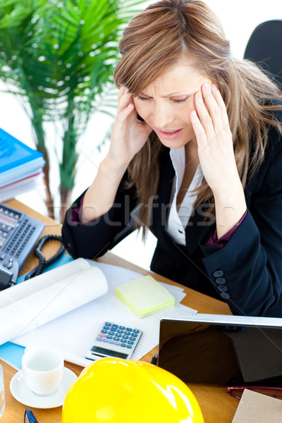 Stressed  businesswoman having a headache in the office  Stock photo © wavebreak_media