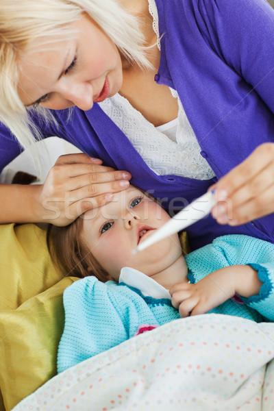 病気 女性 子 ソファ リビングルーム 少女 ストックフォト © wavebreak_media