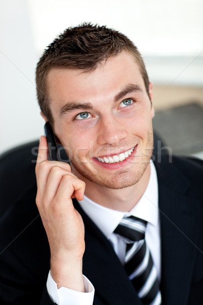 Stock photo: Simper businessman using mobile phone in office