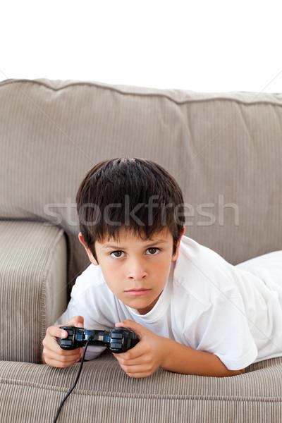 Zagęszczony chłopca gry sofa domu Zdjęcia stock © wavebreak_media