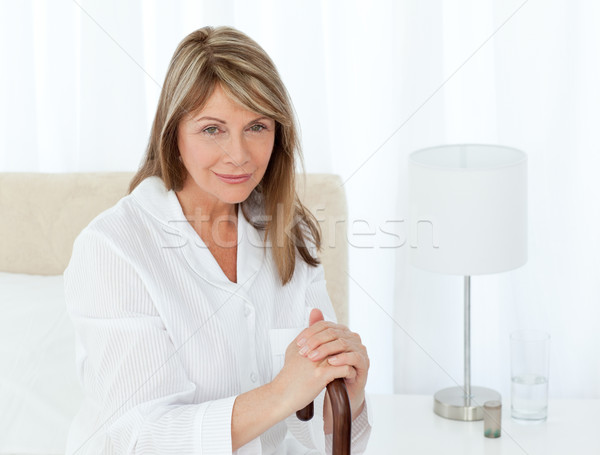 Retired woman with her walking stick at home Stock photo © wavebreak_media