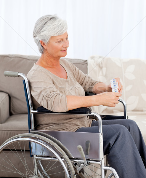 Senior sedia a rotelle pillole spazio anziani ridere Foto d'archivio © wavebreak_media