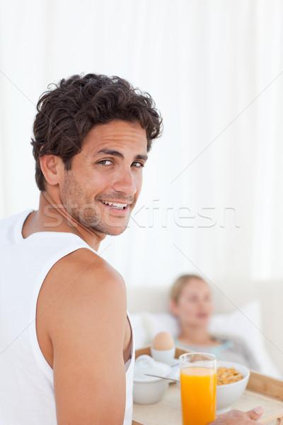 Man bringing the breakfast to his wife Stock photo © wavebreak_media